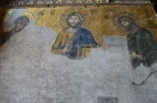 Christ as Pantocrator (Christ as all-powerful) in this Deeis mosaic (This is a technical term where Christ is represented as Pantocrator and Mary and John the Baptist are depicted supplicating for humanity)