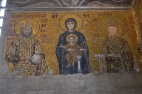 Christ blessing the Emperor and his wife held by the Virgin Mary. Notice how the Emperor is giving money and the Empress a scroll. Very much an imperial image