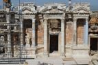 Part of the ornate stage of Hierapolis. A coupld of the statues and friezes in place
